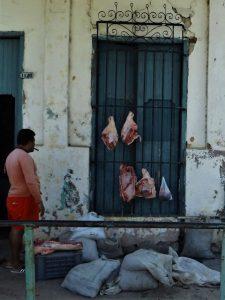 Selling pork meat in Cuba